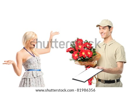 A delivery boy delivering a bunch of flowers and surprised woman isolated on white background - stock photo