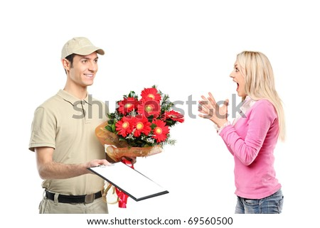 A delivery boy holding a bunch of flowers and surprised woman isolated on white background - stock photo