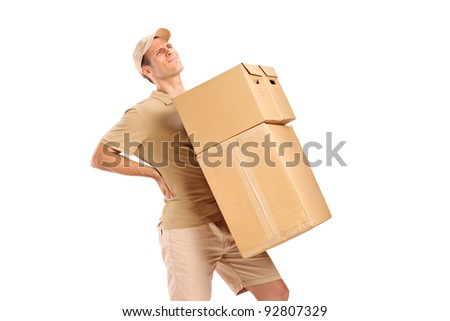 A delivery boy suffering from back pain while carrying boxes isolated on white background