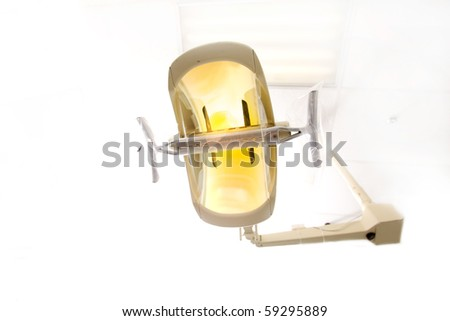 A dentist light or lamp against the ceiling of the room - stock photo