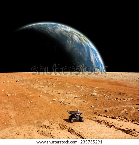A depiction of a rover exploring an airless moon. An Earth like world rises over the horizon. Elements of this image furnished by NASA.