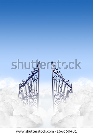 A depiction of the gates to heaven in the clouds open under a clear blue sky background - stock photo