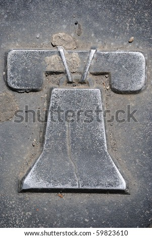 A depiction of the liberty bell on a Philadelphia manhole cover. - stock photo