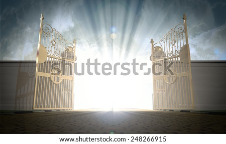 A depiction of the pearly gates of heaven open with the bright side of heaven contrasting with the duller foreground  - stock photo