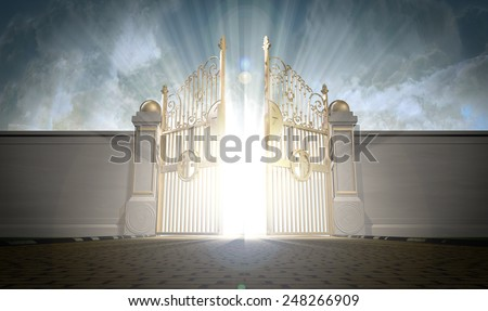 A depiction of the pearly gates of heaven opening with the bright side of heaven contrasting with the duller foreground  - stock photo