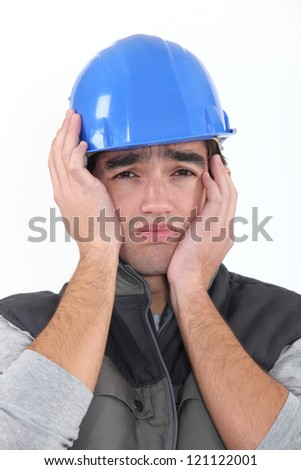 A depressed construction worker. - stock photo