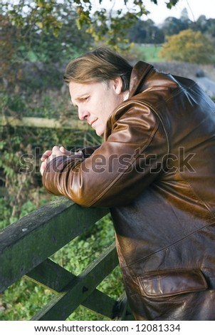 A depressed man in his forties. - stock photo