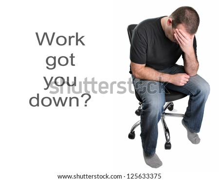 A depressed man is sitting in an office chair, isolated on a white background.