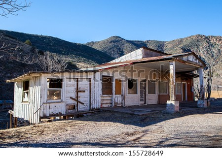 A derelict building sits on a hillside between Cottonwood and Jerome in Arizona, USA - stock photo