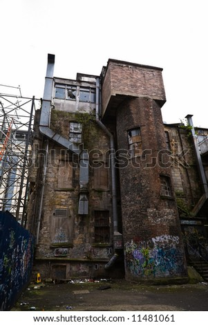 A derelict graffiti covered building in Glasgow, Scotland - stock photo