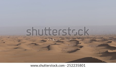 A desert camp in the Sahara desert in Erg Chegaga in Morocco in the spring during a hot sunny day.