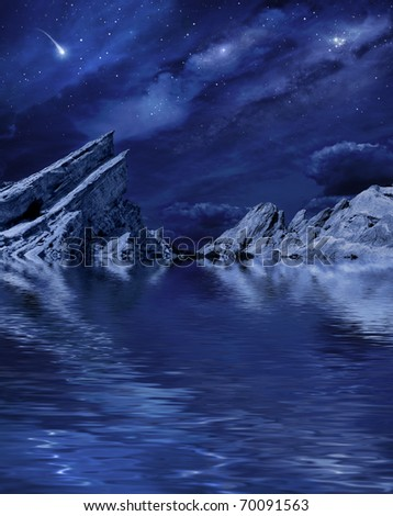A desert landscape at night with moonlight and stars reflected in a calm lake. - stock photo