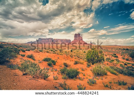 A Desert Landscape of Monument Valley. The official name of Monument Valley is Monument Valley Navajo Tribal Park. Monument Valley is in San Juan County, Utah, United States - stock photo