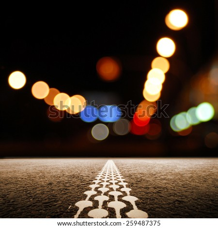A desert road at the night leading off into infinity. - stock photo
