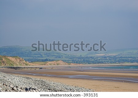 A deserted beach in a beautiful bay - stock photo