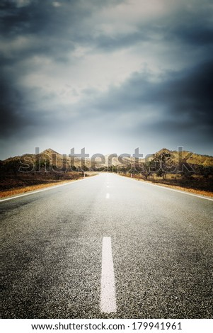 A deserted country road in outback Western Australia, with an instagram effect. - stock photo