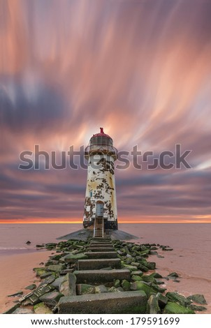A Deserted Lighthouse with a Dramatic Sky at Dusk
