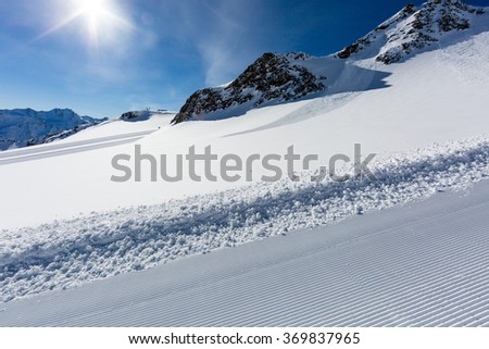 A deserted ski resort in the Alps on a sunny winter day.