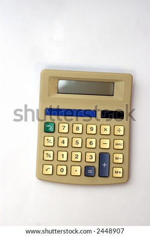 A Desk calculator against a soft white background - stock photo