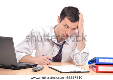 A desperate businessman in his office isolated on white background