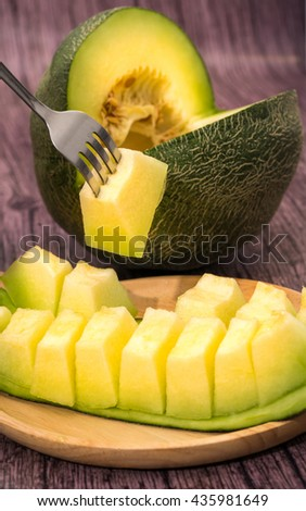 A dessert of pieces of green cantaloupe melon,Sliced ripe spanspek, cantaloupe or sweet melon served on a platter - stock photo