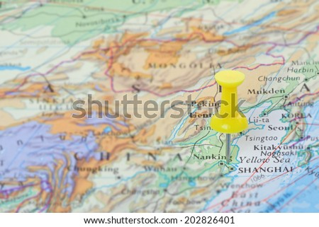 A destination in China marked with a pin on a map - stock photo