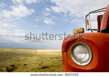 A detail and abstract of a grain truck and prairie landscape. - stock photo