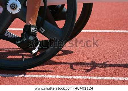 A detail from a male athlete getting ready for a wheelchair race - stock photo