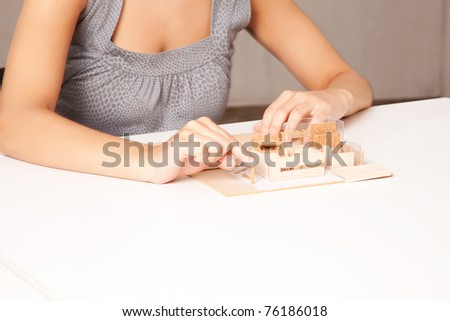 A detail of a interior designer working on a model house - stock photo