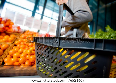 A detail of a man shopping for fruits and vegetables