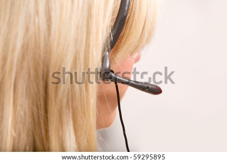 A detail of a receptionist with a headset - stock photo
