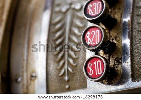 A detail of a vintage dirty cash register
