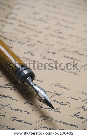 a detail of an old nib on a handwritten letter - stock photo