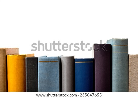 a detail of books in the bookshelf - stock photo