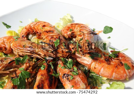 a detail of grilled shrimps - stock photo