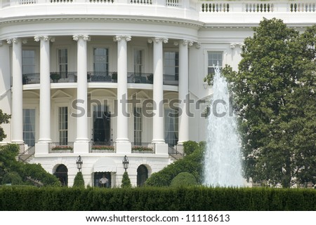 A detail of the south face of the White House in Washington on a hot and hazy summer afternoon.