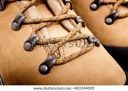 a detail of walking boots with bootlace
