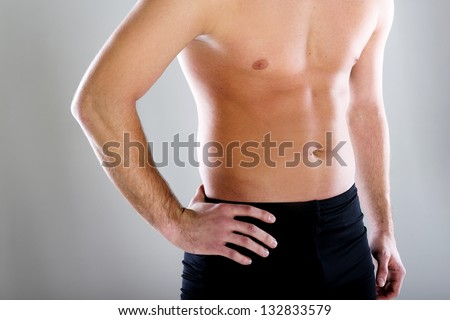 A detail of young sport man with perfect fitness body
