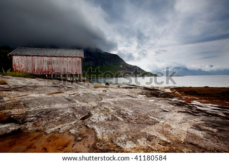 A detail on the coast of a small fishing village in northern Norway - stock photo