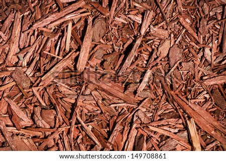 A detailed close up of red coloured cedar mulch.  A great texture image for a background or overlay.    - stock photo