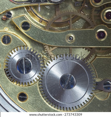 A detailed shot of a clockwork. - stock photo