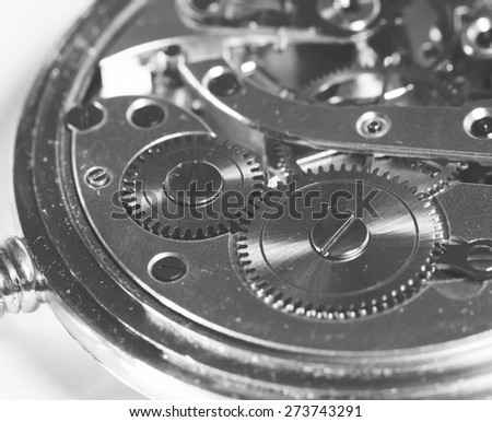 A detailed shot of a clockwork. Image in black and white. - stock photo