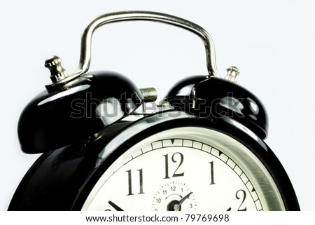 a detailed view of an antique clock in black