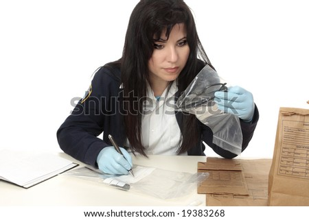 A detective with evidence from a crime scene.  Properly collected and preserved evidence can establish a strong link between an individual and a criminal act. - stock photo