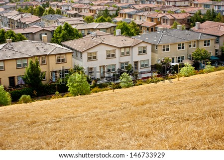 A development of closely-spaced tract homes in San Jose, California. - stock photo