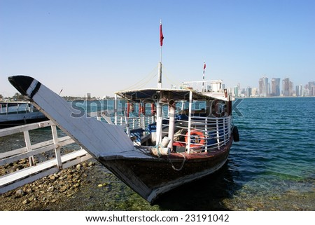 A dhow waits for customers in corniche. Doha Qatar - stock photo