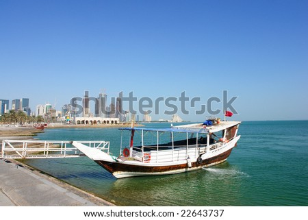 A dhow waits for customers in Doha Qatar - stock photo
