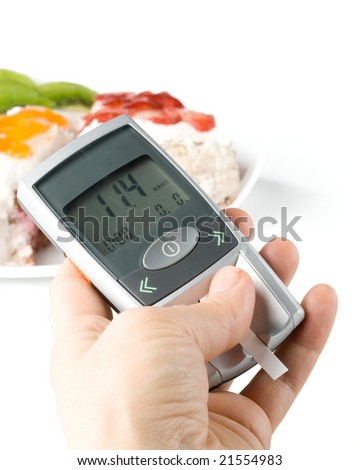 A diabetic looking at a reading on a glucose level monitor - stock photo