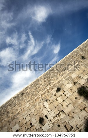 A diagonally tilted view at one of the most sacred places to the Jewish people - the Wailing Wall in the old city of Jerusalem, Israel. - stock photo