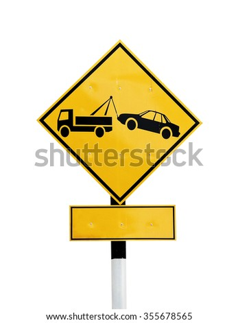 A diamond shaped traffic signboard of a tow truck towing a car, isolated against white.  - stock photo